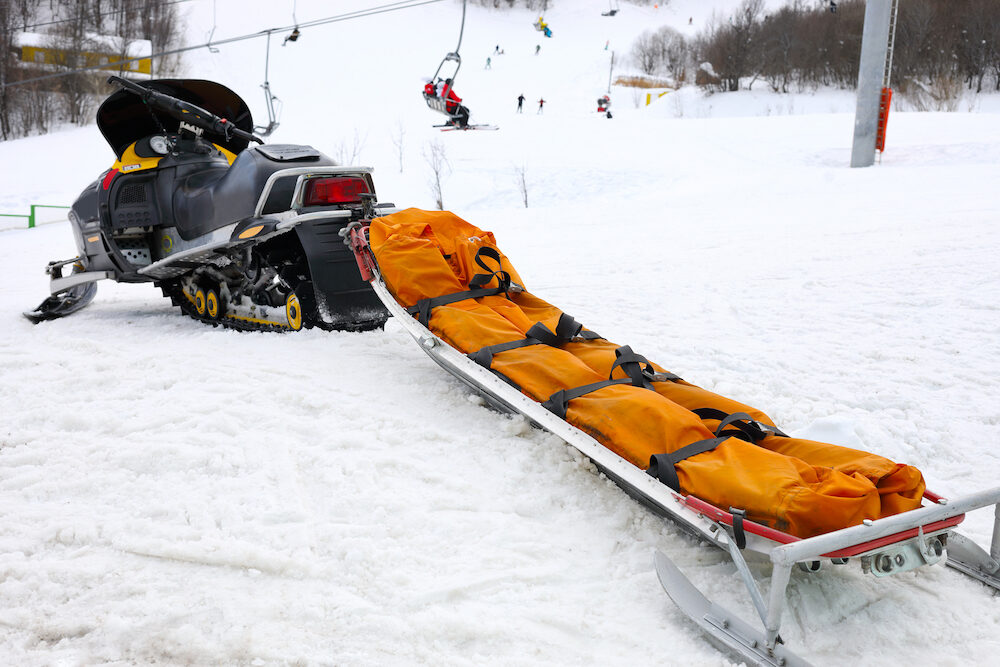 Snowmobile for transportation injured people at ski resort in mountains