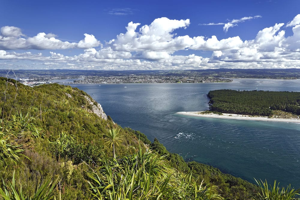 Matakana Island and entrance to harbor from Mount Maunganui. New Zealand