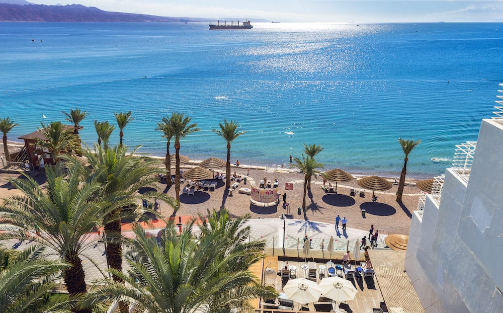 EILAT, ISRAEL - Aerial view on the Red Sea, central public beach and promenade in Eilat - famous vacation spot, resort and recreational city in Israel and Middle East