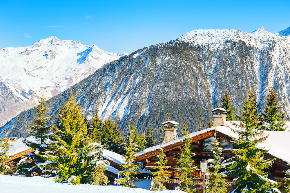 Chalet in the mountains in winter. Courchevel ski resort in French Alps.