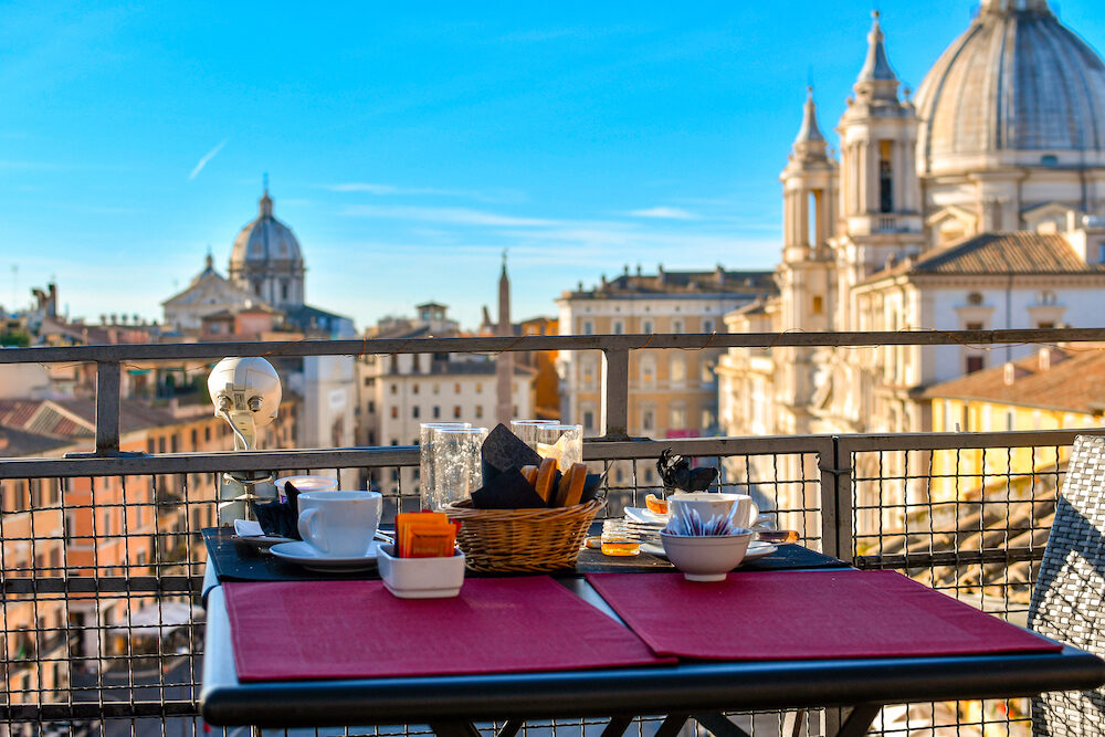Rome, Italy - Leftovers from a continental breakfast on a roof top bar overlooking the Piazza Navona on an early summer morning in Rome, Italy.