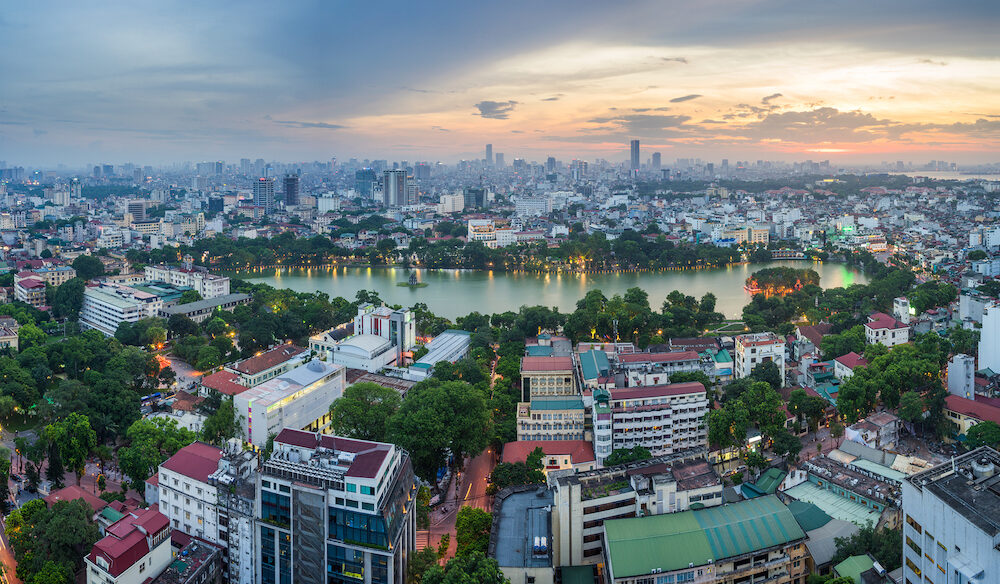 Aerial skyline view of Hoan Kiem lake or Ho Guom, Sword lake area at twilight. Hoan Kiem is center of Hanoi city. Hanoi cityscape.