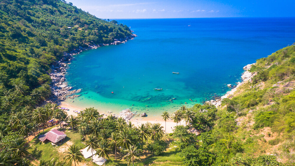 Nui beach or the hidden paradise beach in Phuket. can go by boat good place for diving.the sea is emerald green color there have two clean beaches.The bay is shaped like a horseshoe.no hotel.