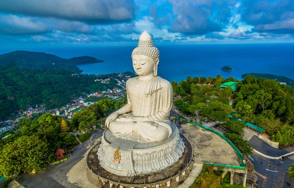 blue sky and blue ocean are on the back of Phuket Big Buddha statue.white Phuket big Buddha is the one of landmarks on Phuket island.