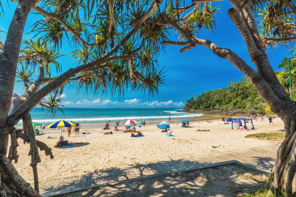 NOOSA, AUSTRALIA, People enjoying summer at Noosa main beach - a famous tourist destination in Queensland, Australia.
