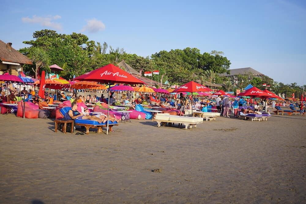 Seminyak, Indonesia - Tourist and local waiting for sunset at Seminyak Beach in Bali, Indonesia.