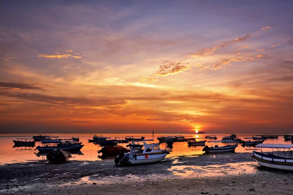 sunrise over fishing boats in Tanjung Benoa, Bali, Indonesia