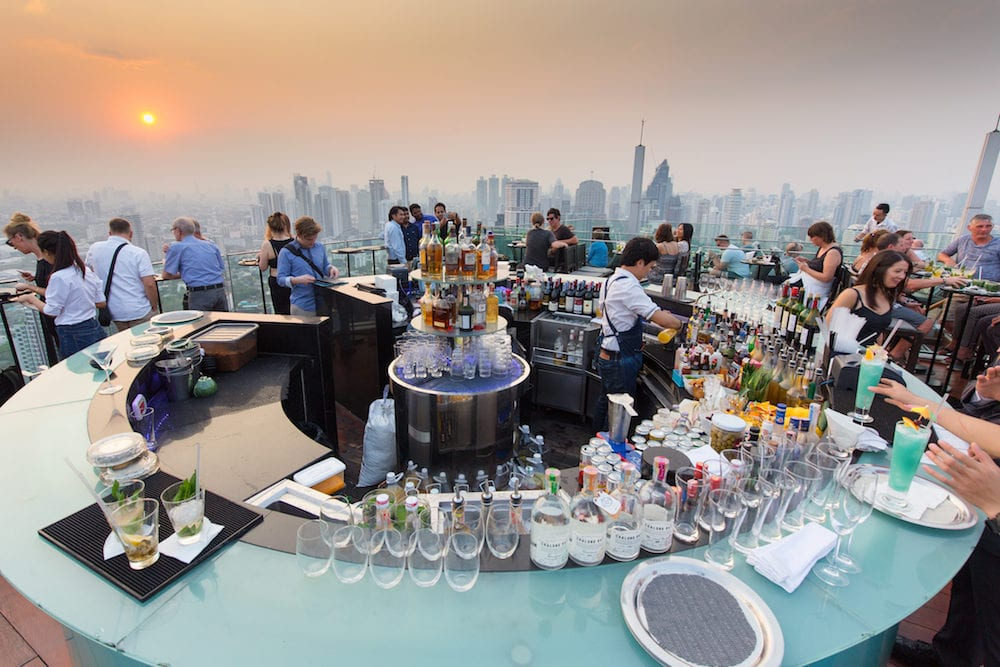 BANGKOK, THAILAND - : People drinking and enjoying the sunset at the Octave rooftop bar of the Marriott tower hotel in the Thong Lor district, Bangkok, Thailand