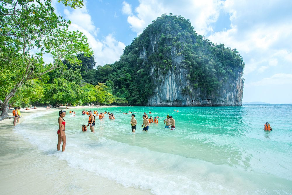 KRABI THAILAND Many people swimming and relaxing at Railay Island in Krabi Province Thailand. Phi Phi is part of Mu Ko Phi Phi National Park