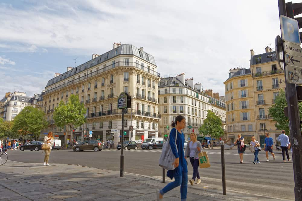 Paris : A woman walking down Saint-Germain-des-Pres in Paris.