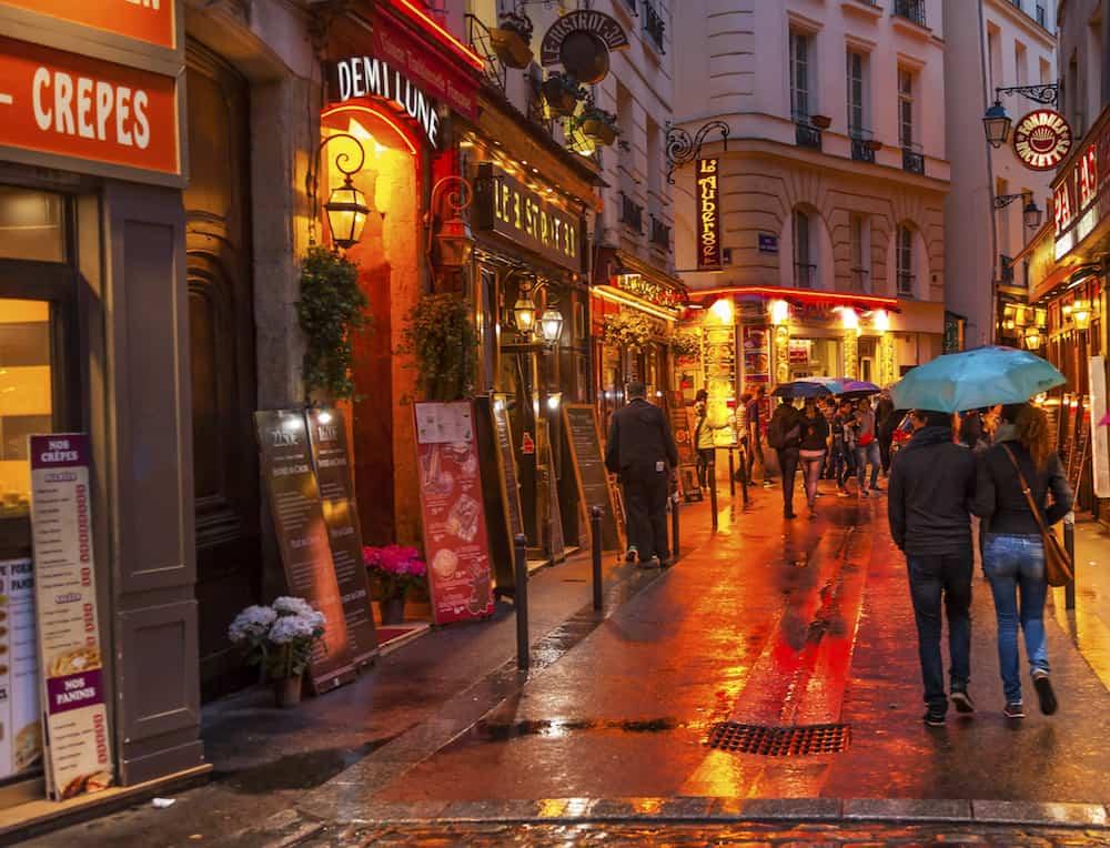 PARIS, FRANCE -Wine Bars Restaurants Colorful Rainy Streets Tourists Lovers Walking Latin Quarter West Bank Seine Latin Quarter Rue De La Harpe Paris France