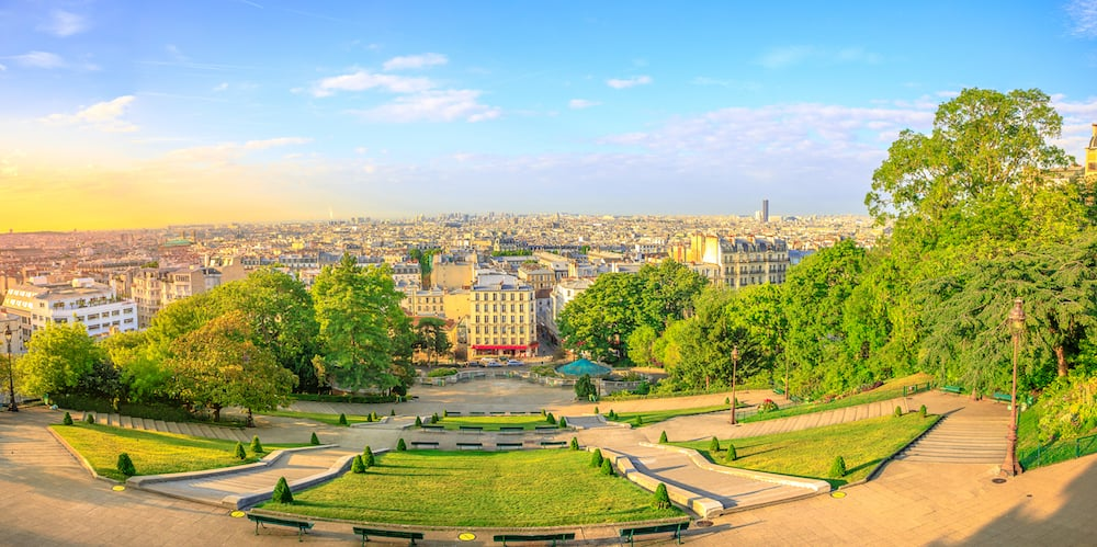 Scenic panorama of Paris at sunset and skyline above Paris. Wide angle view of staircase of Sacred Heart Church from terrace of Cathedral, the highest city point of Paris in Montmartre, France.