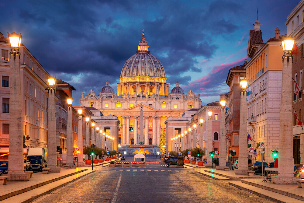 Rome, Vatican City. Cityscape image of illuminated Saint Peter`s Basilica and Street Via della Conciliazione, Vatican City, Rome, Italy.