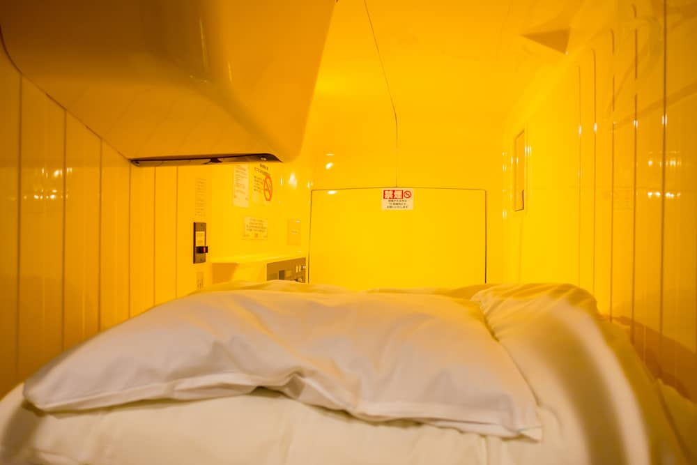 TOKYO, JAPAN Interior view of capsule hotel in city center. Capsule Hotels are less expensive structures very famous in Tokyo, Japan.