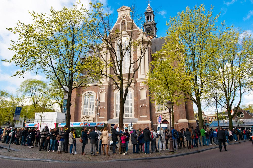 AMSTERDAM-People stand in a queue to the Anne Frank House Museum on April 30,2015.The Anne Frank House Museum is one of Amsterdam's most popular and important museums opened in 1960.