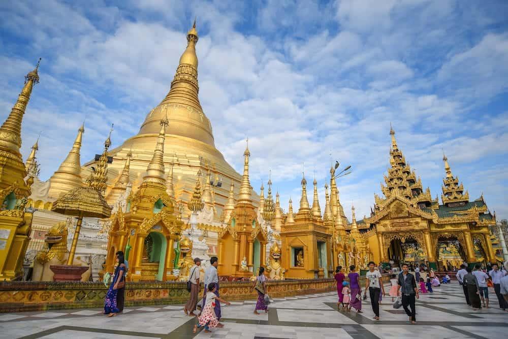 YANGON MYANMAR - Unidentified Burmese people walk inside the area of Shwedagon pagoda (Shwedagon Zedi Daw) famous landmark and travel destination of Yangon Myanmar.