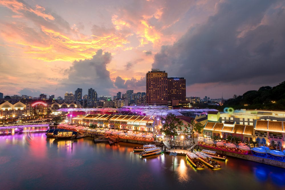 Colorful light building at night in Clarke Quay Singapore. Clarke Quay is a historical riverside quay in Singapore.
