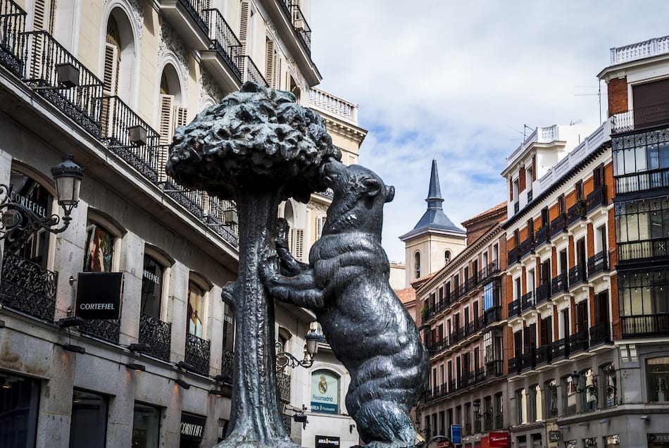 symbol of Madrid statue of bear and strawberry tree puerta del sol Spain, The statue has a plate that says it is geographically located in the center of Spain