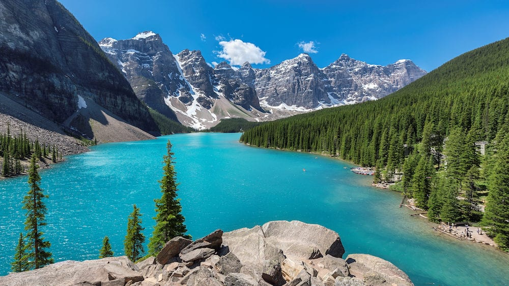 Beautiful turquoise waters of the lake Louise with snow-covered peaks above it in Rocky Mountains, Banff National Park, Canada.