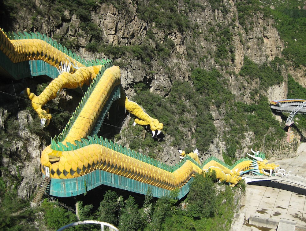 An escalator taking visitors to Longqing Gorge in China is designed to look like a dragon.