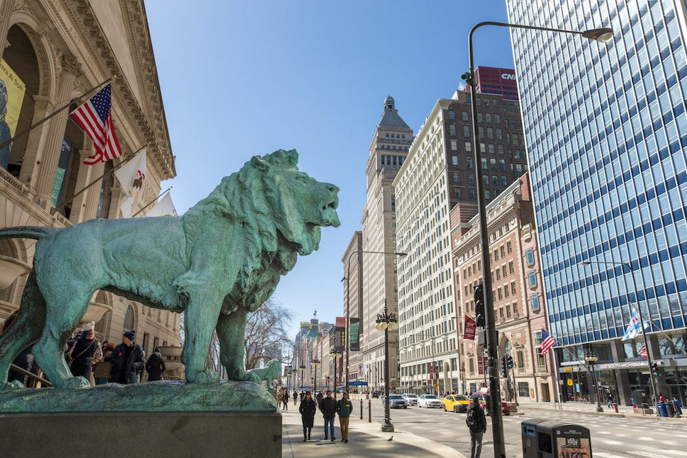 Chicago, USA - Bronze lion statue standing guard at the Art Institute of Chicago. There are two lion statues at the museum's Michigan Avenue entrance. They are famous Chicago landmarks and date to 1894.