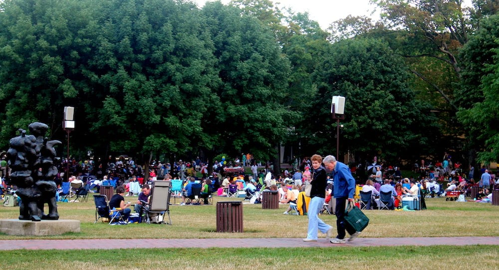 HIGHLAND PARK,ILLINOIS People settling in on the lawn getting ready to the concert circa at the world famous Ravinia music festival in Highland Park,Illinois
