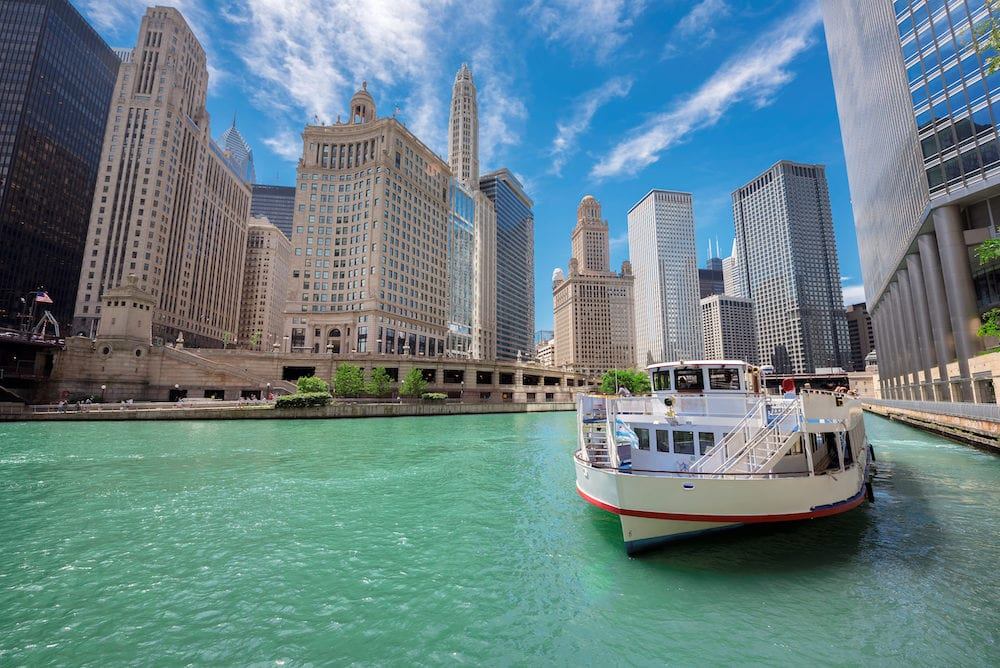 Chicago downtown and Chicago River with tourist ship during sunny day, Illinois, USA.