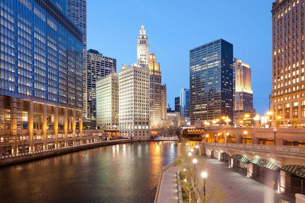 Chicago, Illinois, United States -: A view of Chicago River, riverwalk and office buildings at downtown.