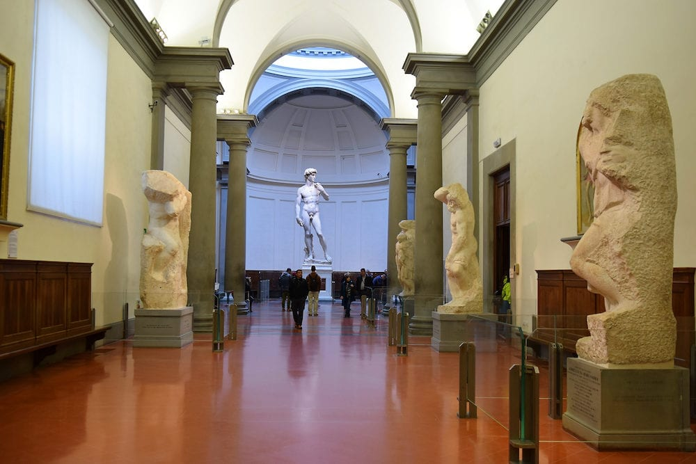 FLORENCE, ITALY - a hall by Michelangelo with David and his unfinished works on display at the Accademia Gallery (Galleria dell'Accademia), Florence, Italy