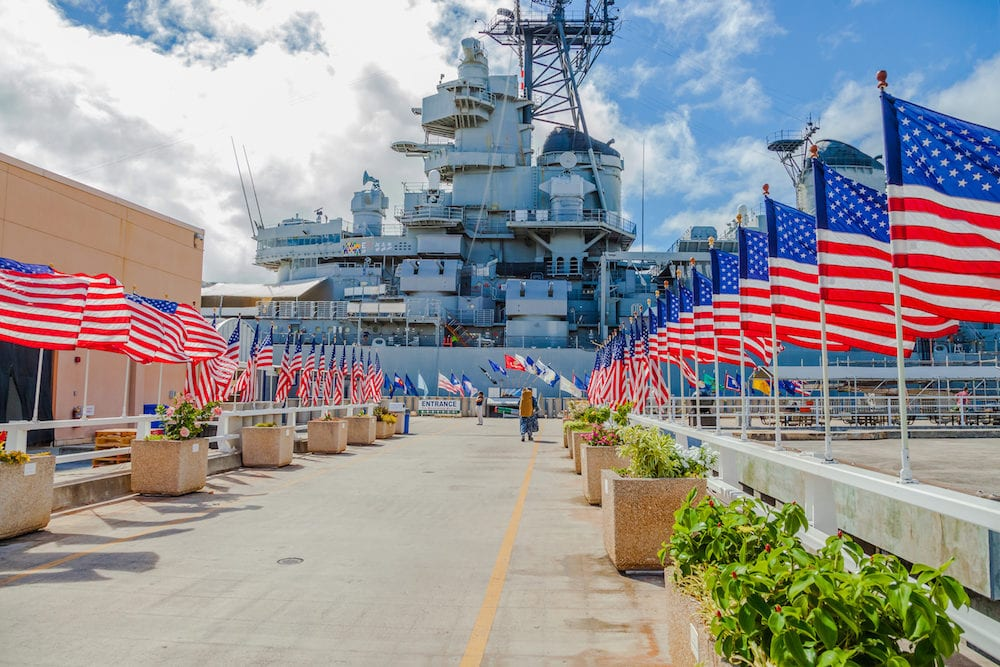 HONOLULU, OAHU, HAWAII, USA - Battleship Missouri Memorial with American flags at Pearl Harbor in Honolulu Hawaii, Oahu island of United States. National historic patriotic landmark.