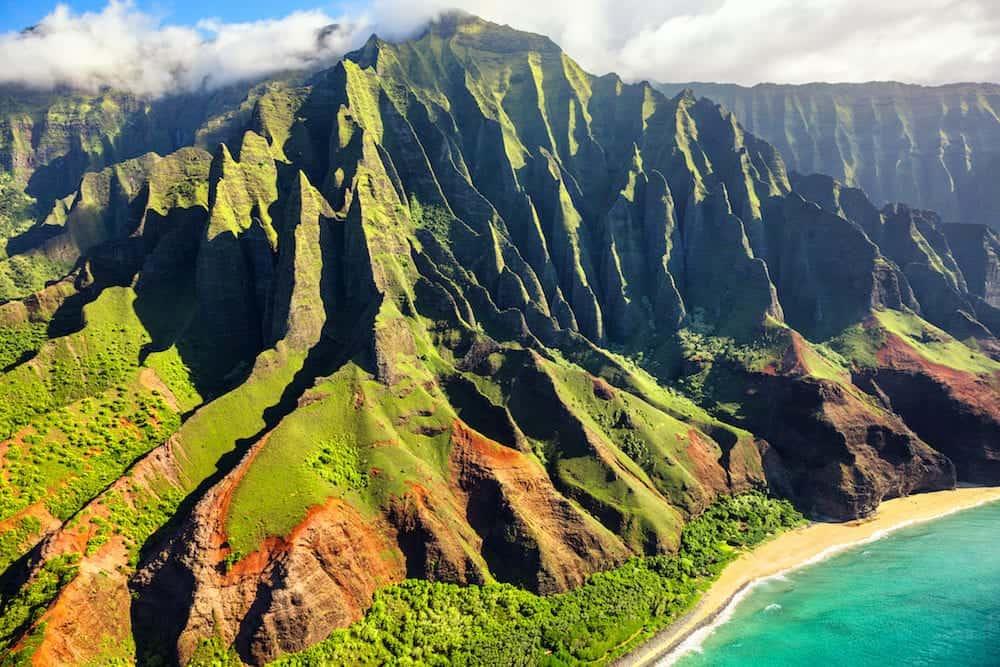 Hawaii nature travel destination. Na Pali coast on Kauai island. Helicopter aerial view of Na Pali Coast mountain landscape in Kauai island, Hawaii, USA.