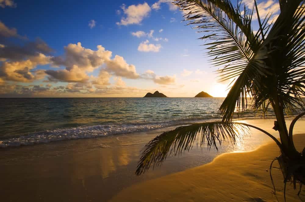 A Pacific sunrise over the Mokulua islands on the windward side of Oahu Hawaii.