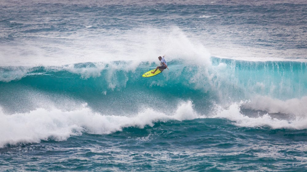 SUNSET BEACH HAWAII USA: Surfer competing at the 2017 Vans World Cup of Surfing competition at Sunset Beach on Oahu's scenic North Shore. This is the second of three surfing competitions and Conner Coffin took first place.
