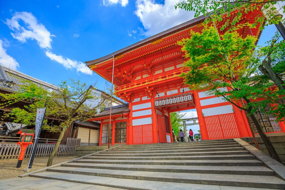Kyoto, Japan - Yasaka Shrine south tower gate in spring season with blue sky. Gion Shrine is one of the most famous shrines in Kyoto between Gion District and Higashiyama District.