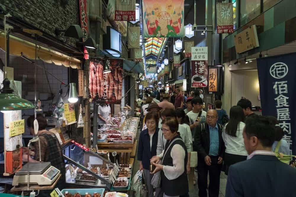 Kyoto, Japan - Shopping at the Nishiki market, Kyoto,called Kyoto's Kitchen, for fresh and prepared fish