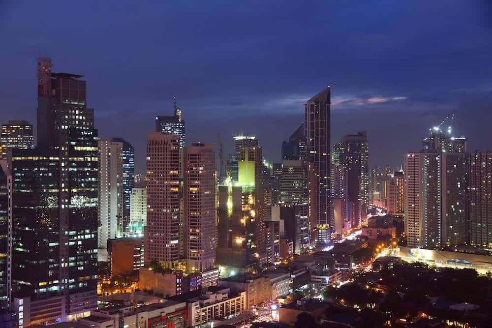 Makati city night skyline in Manila, Philippines. Office buildings.