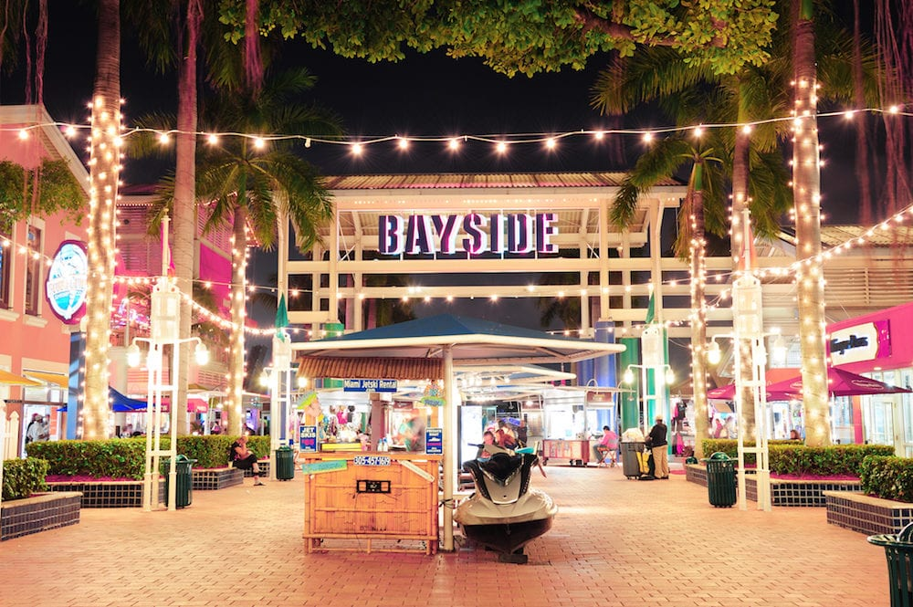 Bayside Marketplace at night. It is a festival marketplace and the top entertainment complex in Downtown Miami attracting 15M people annually.