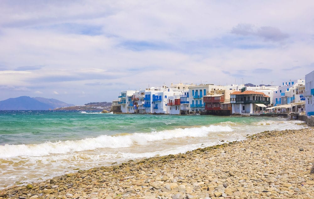 The waves on the sea and clouds in the sky over the Little Venice in Mykonos Island...