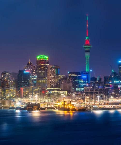 Auckland city skyline at night with city center and Auckland Sky Tower the iconic landmark of Auckland New Zealand.