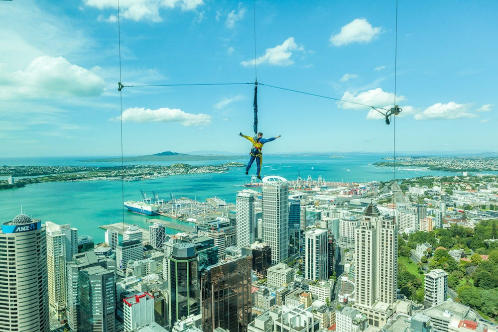 Auckland New Zealand. Bungee jumping man from Auckland sky tower.