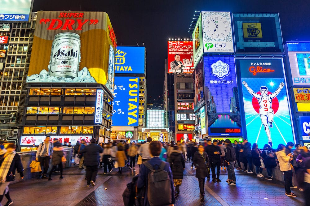 OSAKA, JAPAN - Tourist walking in night shopping street at Dotonbori in Osaka, Japan