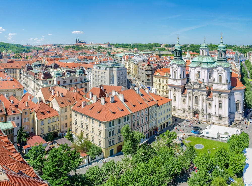 Rooftops of the Old Town, part of the Old Town Square and St. Nicholas Church in Prague. View from the Old Town City Hall to the north west