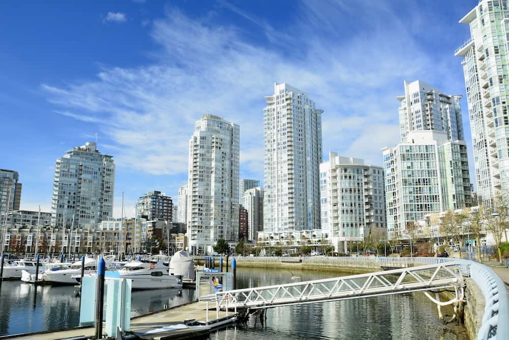 Vancouver BC, Canada. High end luxury condominiums in the Yaletown district of Vancouver.Vancouver skyline with high end real estate in Yaletown.
