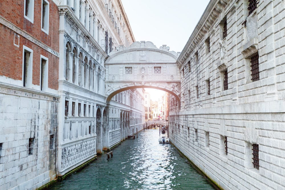 Beautiful view of the bridge of sighs in Venice in gentle pastel colors with rays of sunlight. Italy