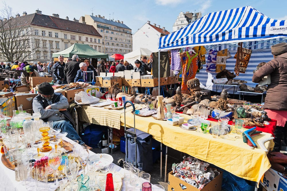 Vienna, Austria -Every Saturday is a flea market at Naschmarkt areain Vienna. Local people and lots of tourists visit the market and looking for bargains and antique stuff.
