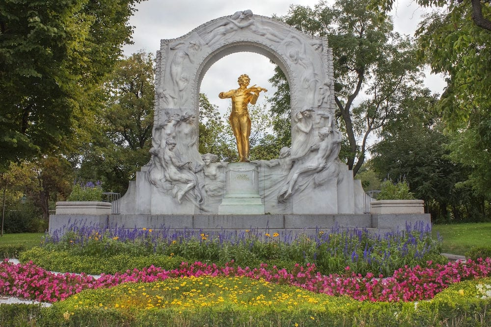 "VIENNA, AUSTRIA - golden monument of ""Waltz King"" Johann Strauss in Stadtpark (City Park) Vienna.The monument was unveiled to the public on 26 June 1921"