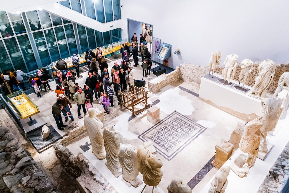 VID CROATIA - People visit museum that was built on site of ancient Roman temple in ancient town Narona in Vid Croatia