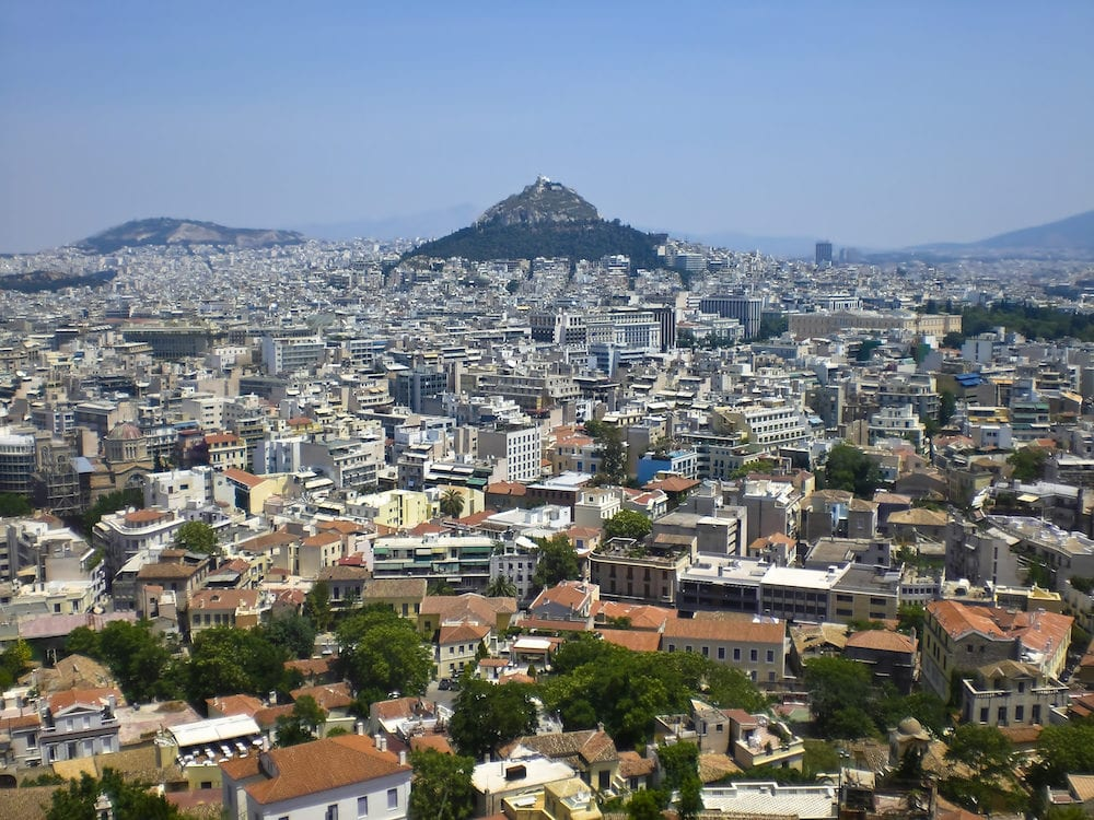 Arial view of Mount Lycabettus and the surrounding populated city.