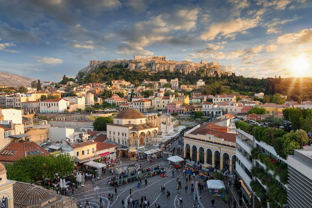 Sunset over the Plaka, the old town of Athens, Greece, with the Parthenon Temple at the Acropolis