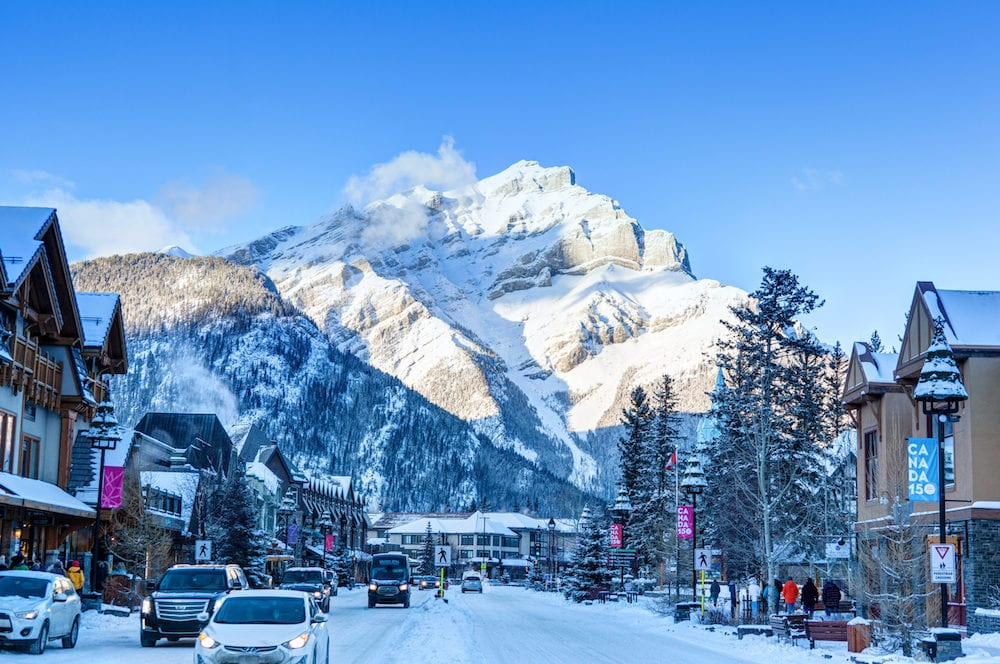 BANFF, CANADA - Winter scene on Banff Avenue in the Banff National Park with Cascade Mountain in the background. The townsite is a major Canadian tourist destination renowned for its mountainous surroundings and hot springs.